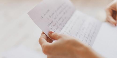 Loyola web3-handwritten-letter-hands-woman-post-shutterstock_611511482-janna-golovacheva-ai1.jpg